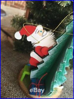 Vintage Emgee Hawaii 1983 Wood Santa Decorating the Christmas Tree Ornament