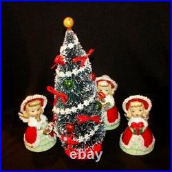 Vintage Lefton Girl Bells Figurines around decorated Bottle Brush Christmas Tree